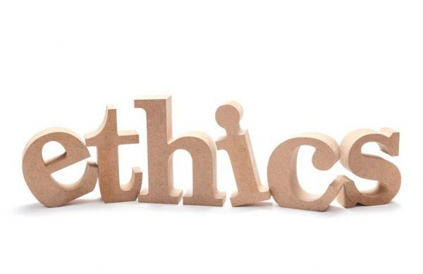 ETHICS wood word on white background